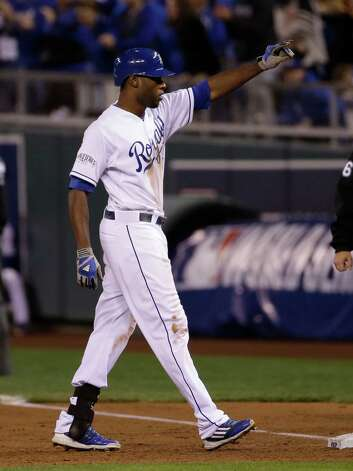 Kansas City Royals Lorenzo Cain points to his bench after hitting a single during the third inning of Game 7 of baseball's World Series against the San Francisco Giants Wednesday, Oct. 29, 2014, in Kansas City, Mo. (AP Photo/Matt Slocum)  ORG XMIT: WS136 Photo: Matt Slocum / AP
