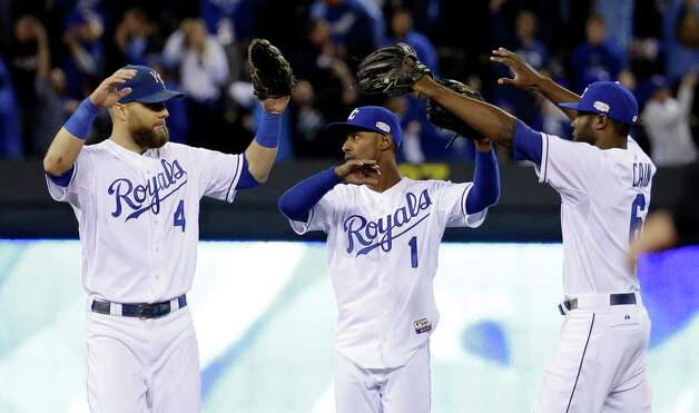 Kansas City Royals' Alex Gordon (4), Jarrod Dyson (1) and Lorenzo Cain (6) celebrate after Game 6 of baseball's World Series against the San Francisco Giants Tuesday, Oct. 28, 2014, in Kansas City, Mo. The Royals won 10-0 to tie the series at 3-3.  (AP Photo/David J. Phillip)  ORG XMIT: WS357 Photo: David J. Phillip / AP