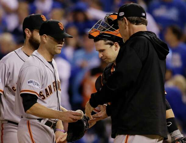 San Francisco Giants manager Bruce Bochy relieves starting pitcher Tim Hudson, left, during the second inning of Game 7 of baseball's World Series against the Kansas City Royals Wednesday, Oct. 29, 2014, in Kansas City, Mo. (AP Photo/Charlie Neibergall)  ORG XMIT: WS134 Photo: Charlie Neibergall / AP