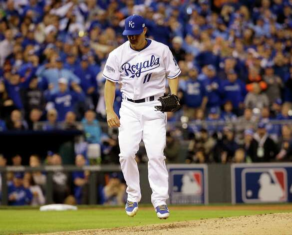 Kansas City Royals' Jeremy Guthrie hops after striking out San Francisco Giants' Buster Posey during the third inning of Game 7 of baseball's World Series Wednesday, Oct. 29, 2014, in Kansas City, Mo. (AP Photo/David J. Phillip)  ORG XMIT: WS330 Photo: David J. Phillip / AP