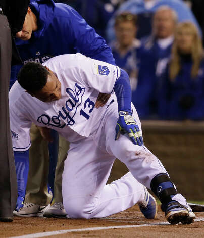 Kansas City Royals Salvador Perez checks on his leg after being hit by pitch by San Francisco Giants Tim Hudson during the second inning of Game 7 of baseball's World Series Wednesday, Oct. 29, 2014, in Kansas City, Mo. (AP Photo/Charlie Neibergall)  ORG XMIT: WS135 Photo: Charlie Neibergall / AP