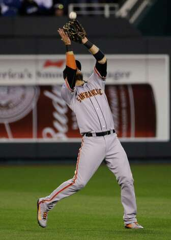 San Francisco Giants Brandon Crawford catches a fly ball by Kansas City Royals Eric Hosmer during the sixth inning of Game 7 of baseball's World Series Wednesday, Oct. 29, 2014, in Kansas City, Mo. (AP Photo/Matt Slocum)  ORG XMIT: WS156 Photo: Matt Slocum / AP