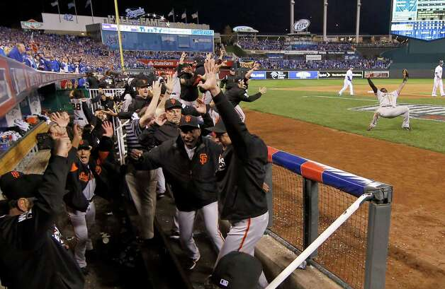 San Francisco Giants players in the dugout celebrate after Game 7 of baseball's World Series against the Kansas City Royals Wednesday, Oct. 29, 2014, in Kansas City, Mo. The Giants won 3-2 to win the series. (AP Photo/Matt Slocum)  ORG XMIT: WS703 Photo: Matt Slocum / AP