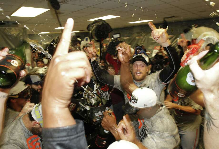 With Hunter Pence (right center) in the house, the Giants enjoy their 13th Champagne celebration in five seasons after World Series Game 7. Photo: Michael Macor / The Chronicle / ONLINE_YES