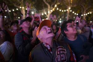 Fans go wild as Giants hammer down World Series win - Photo