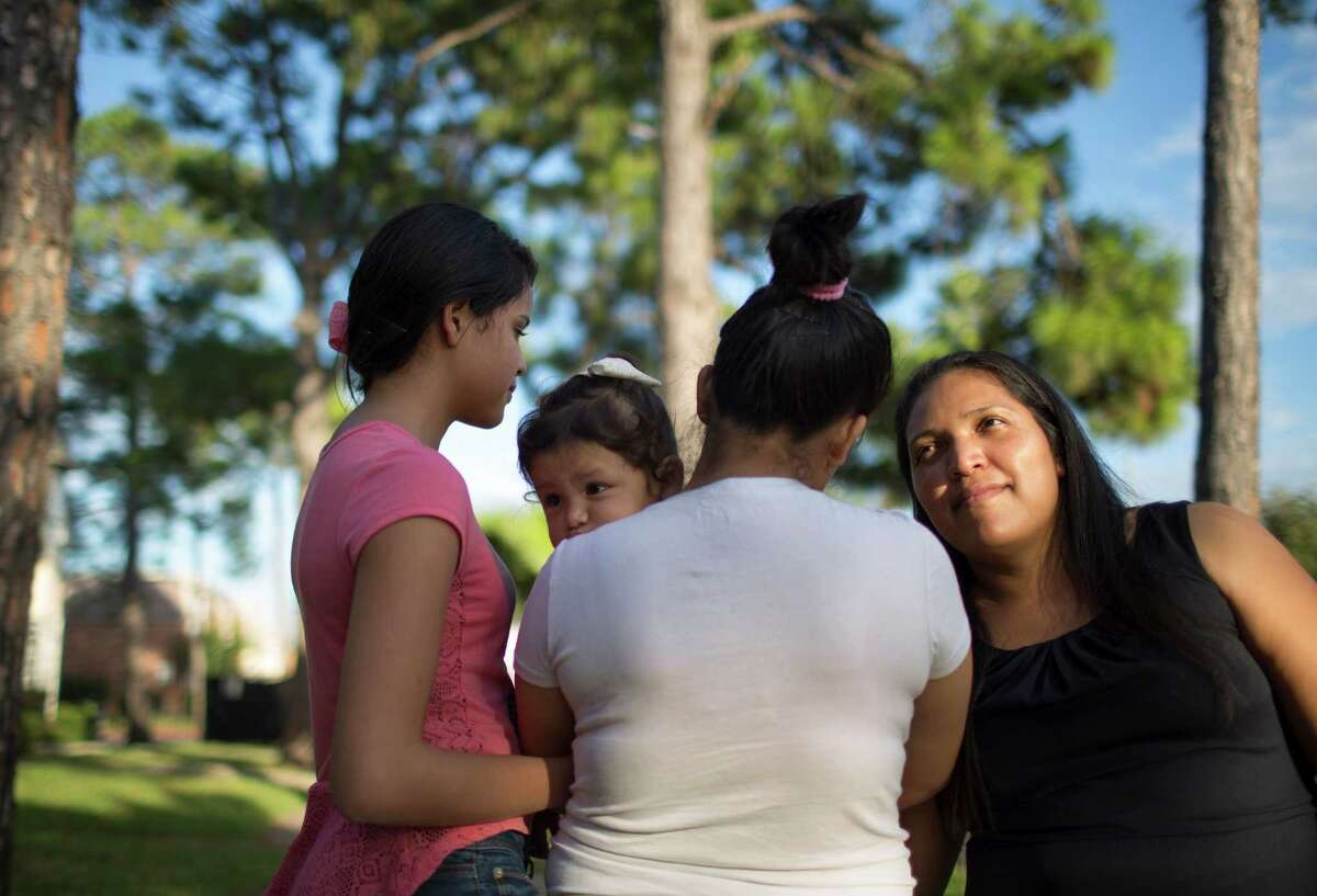 Claudia Palma, right, with her daughters and granddaughter. They have fled their native Honduras and are now applying for asylum, Thursday, Oct. 23, 2014 in Houston.