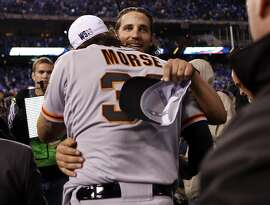 San Francisco Giants' Madison Bumgarner and Michael Morse embrace after 3-2 win over Kansas City Royals in Game 7 of the World Series at Kauffman Stadium in Kansas City, Missouri. on Wednesday, October 29, 2014.