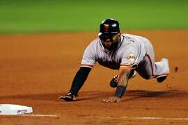 KANSAS CITY, MO - OCTOBER 29: Pablo Sandoval #48 of the San Francisco Giants slides into third base in the fourth inning against the Kansas City Royals during Game Seven of the 2014 World Series at Kauffman Stadium on October 29, 2014 in Kansas City, Missouri.  (Photo by Elsa/Getty Images)