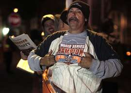 Ralph Staben is among the small group of fans that wait for the Giants to arrive back at AT&T Park in San Francisco, Calif. on Thursday, Oct. 30, 2014 after beating the Kansas City Royals in Game 7 of the World Series.