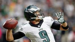 Philadelphia Eagles' Nick Foles warms up prior to an NFL football game against the Arizona Cardinals, Sunday, Oct. 26, 2014, in Glendale, Ariz. (AP Photo/Ross D. Franklin)