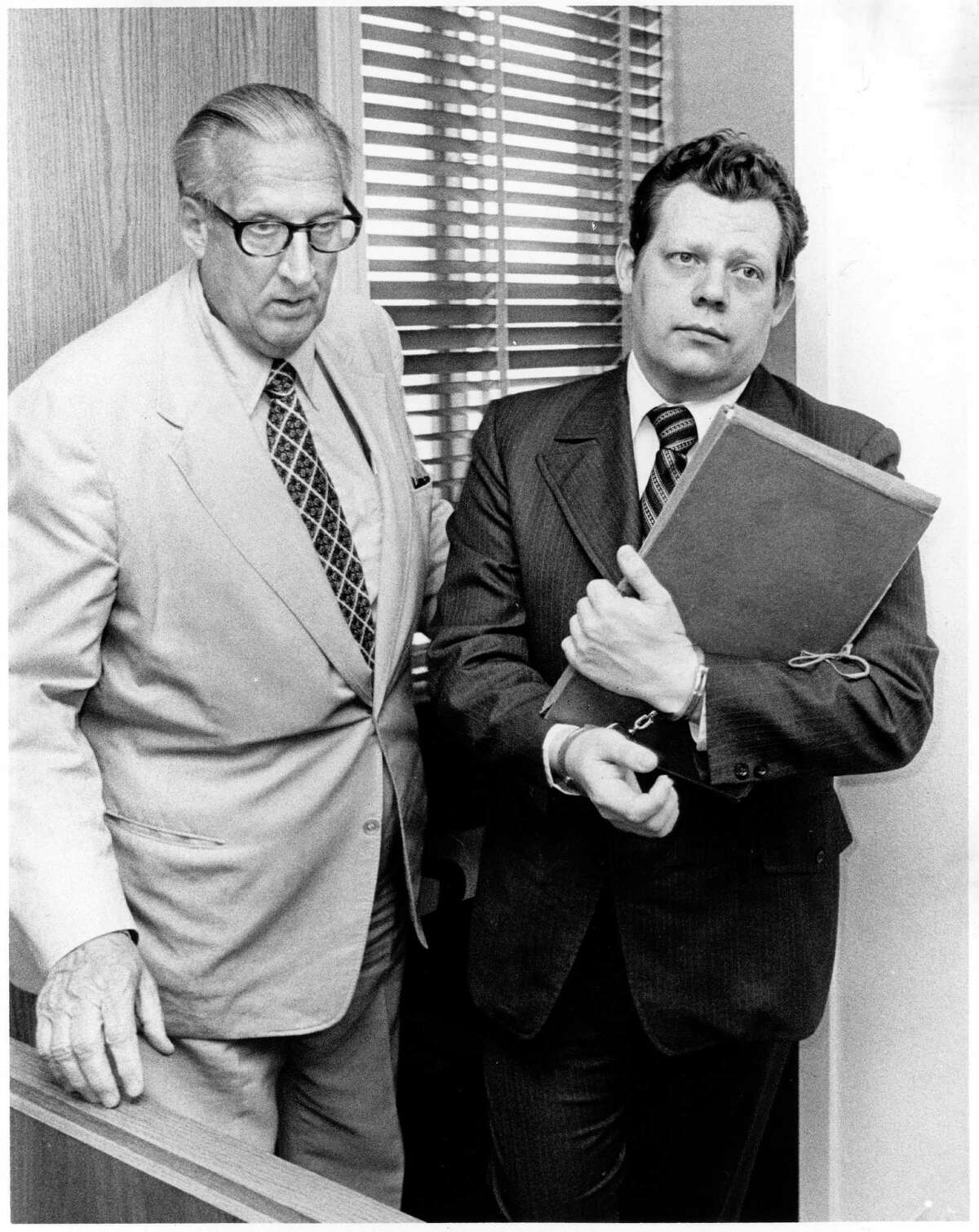 Here, Ronald Clark O'Bryan, right, is escorted from the courtroom by a bailiff after hearing the guilty verdict on June 3, 1975. He was sentenced to death.