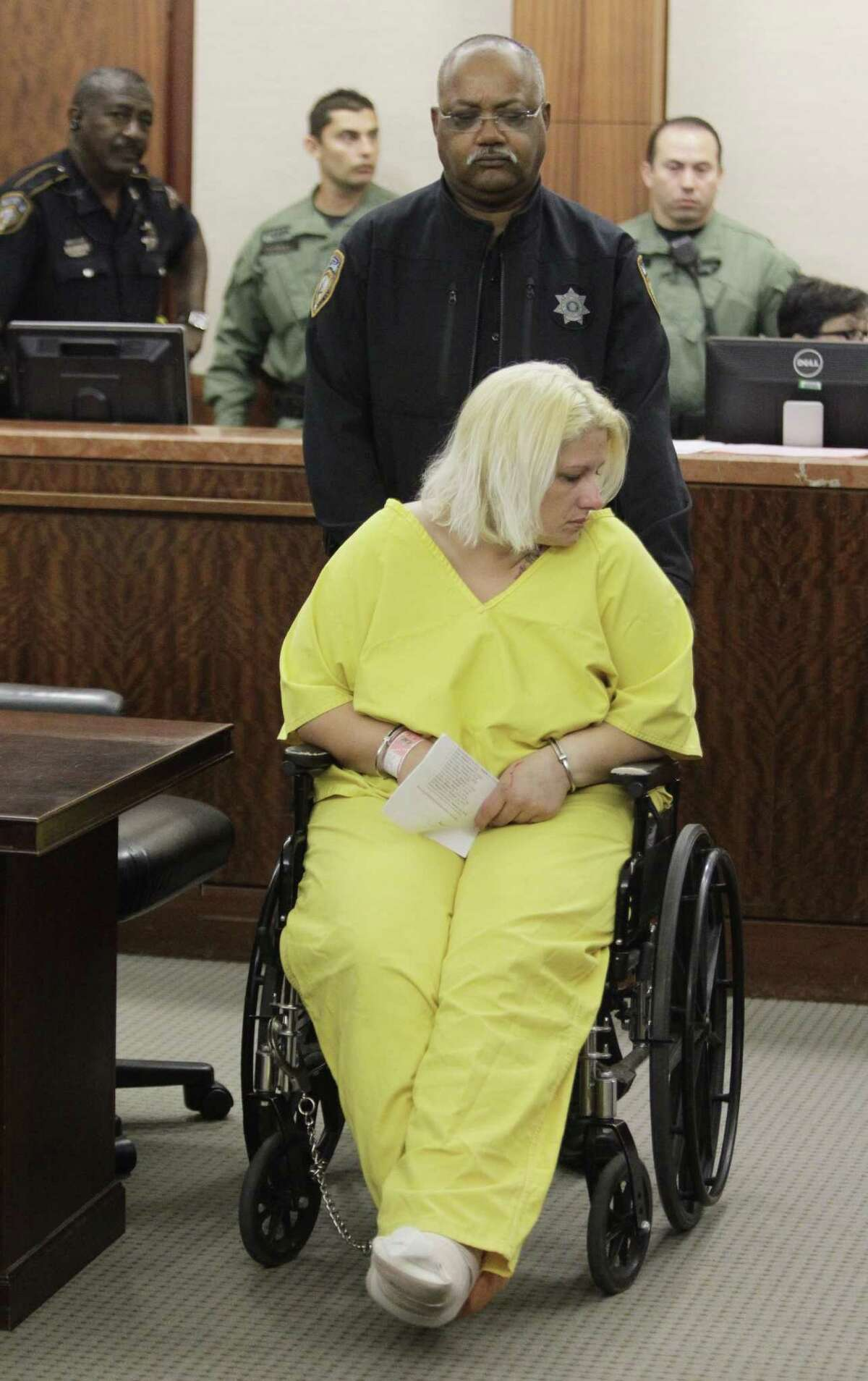 Kelly Jo Ivey appears in court Thursday, Oct. 30, 2014, charged in the head-on crash that killed Harris County sheriff's deputy Jesse Valdez III.