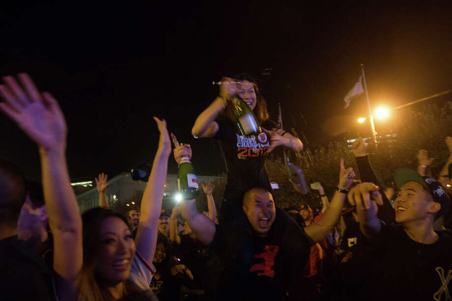 Giants fans celebrate the San Francisco Giants winning the 2014 World Series at the Civic Center. Photo: SF Gate / Douglas Zimmerman
