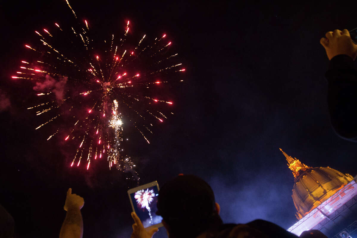 Fireworks go off as Giants fans celebrate the San Francisco Giants winning the 2014 World Series at the Civic Center.