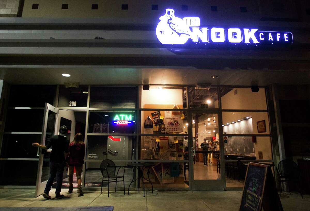 Students walk by the Nook Cafe at the University of Houston campus on Thursday, Oct. 23, 2014, in Houston.