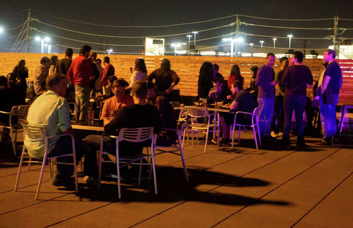 Students hang out at the Calhoun's a rooftop bar at the University of Houston campus on Thursday, Oct. 23, 2014, in Houston.