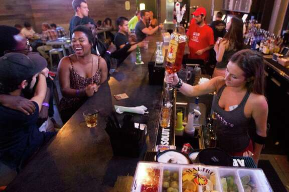 Students enjoy a drink at the Calhoun's rooftop bar at the University of Houston campus on Thursday, Oct. 23, 2014, in Houston.