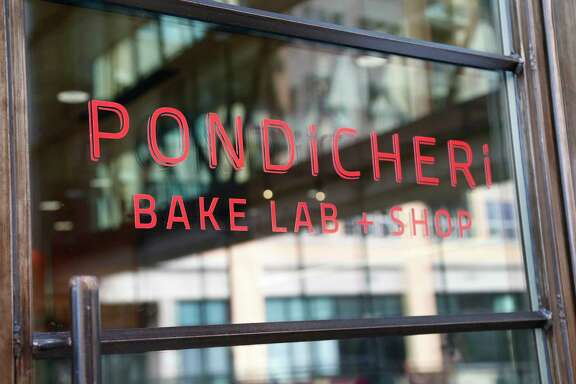 Exterior sign at the newly opened Pondicheri Bake Lab in a space above the restaurant in West Ave at Kirby.