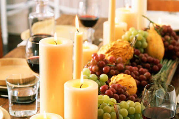 """1. Pick a candle, any candle.  """"Candles are a classic way to add a joyous mood to your home,"""" says interior designer  Anna Hackathorn . """"I especially love a large group of 15 or so white pillar candles in various heights, massed together on a large plate or tray in the center of the dining table."""" And while any candles displayed on your table while food is being served should be unscented, placing scented candles around your home is great way to create ambiance and make any room feel cozier. """"Select a fragrance that reminds you and your guests of the season,"""" says interior designer  James Wheeler . """"Candles in scents of pumpkin, spice and apple are easy to find, and I particularly love thewarmness of  tobacco and sandalwood .""""      15 Effortlessly Beautiful DIY Fall Centerpieces   9 Fun Fall Party Treats   6 Fresh Fall Items for Your Home   20 Inspiring DIY Projects   17 Crazy-Delicious Recipes Served in Mason Jars   8 Color Rules To Follow For A Brighter, Happier Home"""