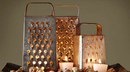 Box Grater Luminaries  Create moody ambience on a sideboard with this flickering display.    Step 1: Arrange multiple vintage box graters (we found ours on  Etsy ) on a tray. Illuminate with flameless flickering LED votives  ($13.99 for a box of 12; amazon.com )  to prevent the metal graters from becoming too hot to handle.    Step 2: Fill in gaps on tray with acorns and extra candles.    RELATED:   11 Festive Ideas for Thanksgiving Decorations       15 Effortlessly Beautiful DIY Fall Centerpieces   9 Fun Fall Party Treats   6 Fresh Fall Items for Your Home   20 Inspiring DIY Projects   17 Crazy-Delicious Recipes Served in Mason Jars   8 Color Rules To Follow For A Brighter, Happier Home