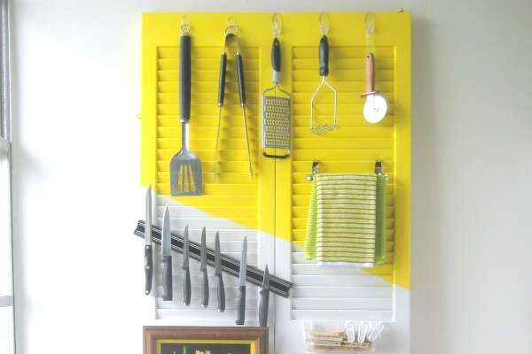 Door Storage Not only does this closet door add interest to this kitchen (we love that pop of sunny yellow!), but the slats offer tons of spots for hanging cooking tools-even a magnetic knife rack. See more at C.R.A.F.T. » 19 Smart Solutions for Around the House7 Diet Mistakes Nutritionists Are Sick of Seeing You Make21 Cleaning Problems You Can Solve With Baking Soda10 Bizarre Things Your Body Does While You Sleep10 Sneaky Ways to Hide Household Eyesores7 Super-Smart Ways to Organize Under the Sink