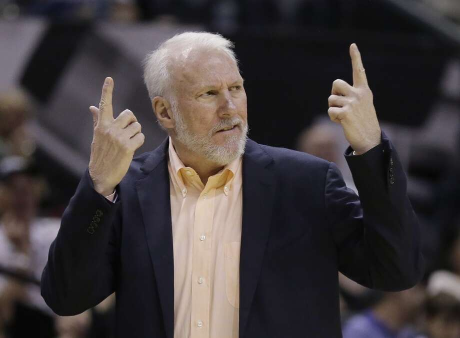 San Antonio Spurs' Gregg Popovich, looking a bit like an angry Sean Connery, questions a call during the first half of an NBA preseason basketball game against the Sacramento Kings, Monday, Oct. 20, 2014, in San Antonio. (AP Photo/Eric Gay) Photo: Eric Gay, AP
