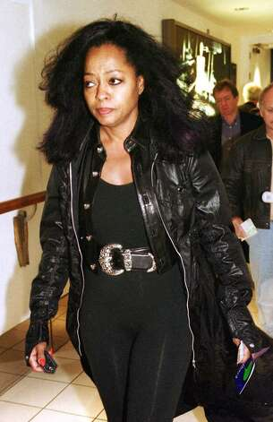 American singer Diana Ross walks toward her plane at Heathrow Airport in London, Wednesday, Sept. 22 1999, after she was searched at a security check. Ross was arrested soon after when a female security officer who had attempted to search the singer complained of being assaulted. Police arrested her aboard the aircraft, the British Broadcasting Corp. reported.(AP Photo/ Str) **UK OUT NO SALES NO MAGS** Photo: File Photo / Greenwich Time File Photo