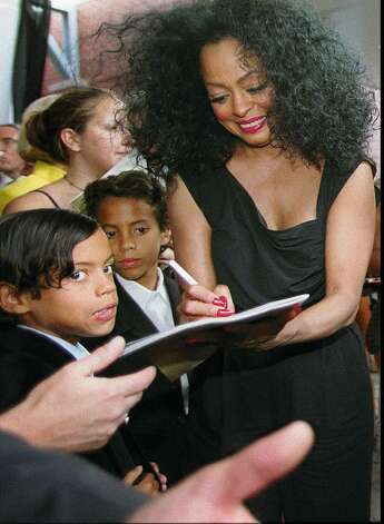 Greenwich, May 31, 1998.  Singer, and Greenwich Resident Diana Ross signs autographs after the benefit concert at Greenwich Academy.  She is surrounded by her two sons Ross and Evan (no id on which is which).  Photo/Helen Neafsey color. Photo: File Photo / Greenwich Time File Photo
