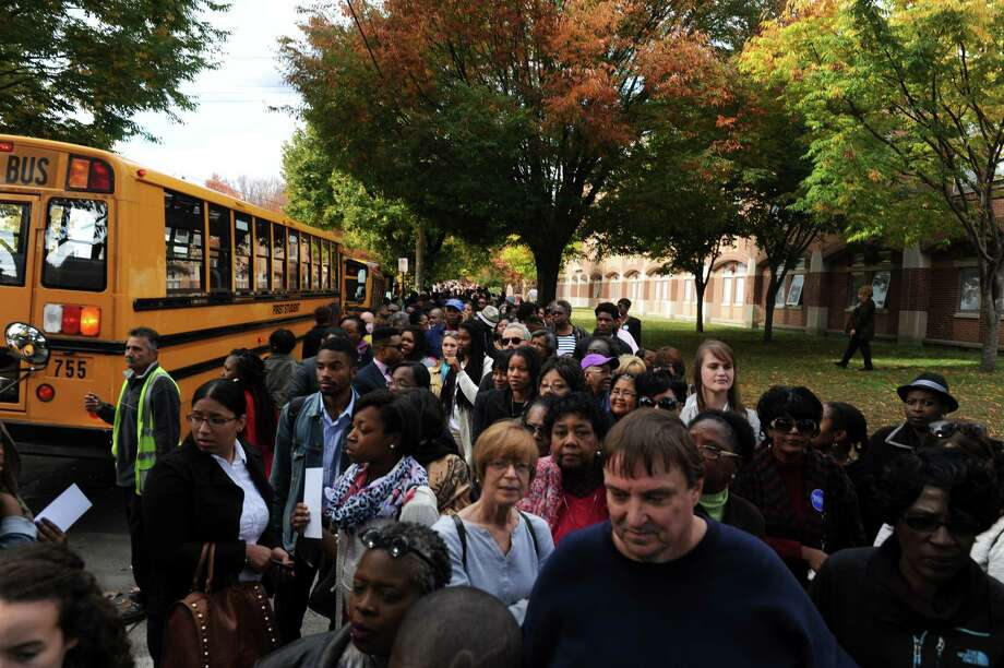 A crowd of supporters line Mitchell Drive Thursday, Oct. 30, 2014, in hopes of seeing Michelle Obama rally for the vote at Wilbur Cross High School in New Haven, Conn. Photo: Autumn Driscoll / Connecticut Post
