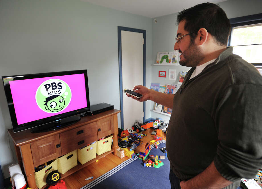 Cutting the cord from cable, Jason Klein now utilizes online streaming services like Hulu Plus for television shows at his home in Trumbull, Conn. on Thursday, October 30, 2014. Photo: Brian A. Pounds / Connecticut Post
