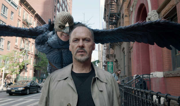 """Birdman""IMDb: 8.8/10Review by Mick LaSalle: 'Birdman' flies as one of best movies of '14Five StarsAny conversation about ""Birdman or (The Unexpected Virtue of Ignorance)"" must begin with a description of how it was filmed. It was shot in long takes, many of which involved following characters down hallways and in out of tight corners and small dressing rooms. Then it was strung together in such a way that it plays as though the entire movie were done in one unbroken shot. Photo: Fox Searchlight Pictures / ONLINE_CHECK"
