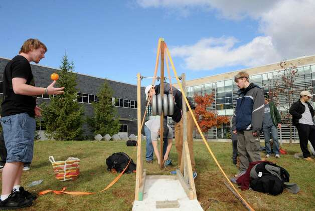 HVCC engineering students on team Awesome ready their pumpkin launcher during the Pumpkin Palooza Fall Festival for Students and Community at Hudson Valley Community College on Thursday Oct. 30, 2014 in Troy, N.Y. (Michael P. Farrell/Times Union) Photo: Michael P. Farrell / 00029264A