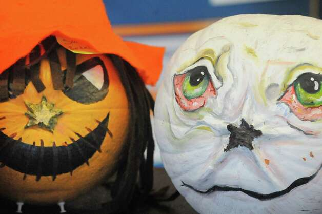 Two of the decorated pumpkin entries in the Jack-o-lantern contest part of the Pumpkin Palooza Fall Festival for Students and Community at Hudson Valley Community College Thursday Oct. 30, 2014, in Troy, N.Y. (Michael P. Farrell/Times Union) Photo: Michael P. Farrell / 00029264A