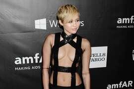 Recording artist Miley Cyrus  attends amfAR LA Inspiration Gala honoring Tom Ford at Milk Studios on October 29, 2014 in Hollywood, California.