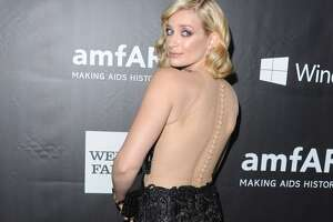 Actress Beth Behrs arrives at the 2014 amfAR LA Inspiration Gala at Milk Studios on October 29, 2014 in Hollywood, California.