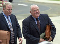 Michael Skakel, right, arrives at State Superior Court in Stamford, Conn., on Wednesday, July 30, 2014, with his attorney, Stephan Seeger, left.