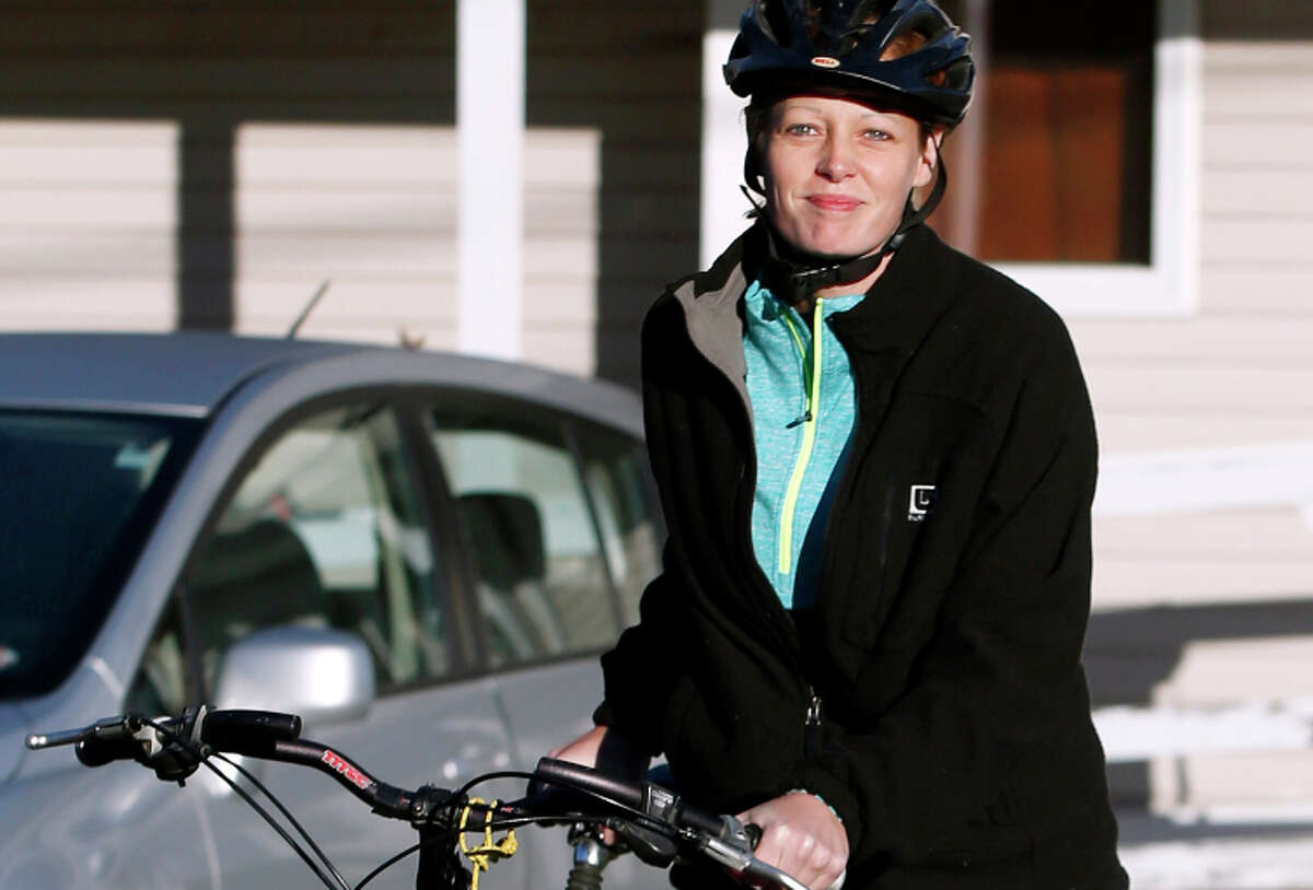 Kaci Hickox prepares to go for a bike ride in Fort Kent, Maine. Nurse Kaci Hickox leaves her home on a rural road in Fort Kent, Maine, to take a bike ride with her boyfriend Ted Wilbur, Thursday, Oct. 30, 2014. The couple went on an hour-long ride followed by a Maine State Trooper. State officials are going to court to keep Hickox in quarantine for the remainder of the 21-day incubation period for Ebola that ends on Nov. 10. Police are monitoring her, but can't detain her without a court order signed by a judge. (AP Photo/Robert F. Bukaty)