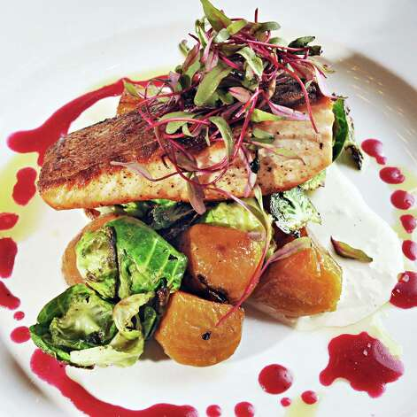 Pan-roasted salmon at Next Door Kitchen & Bar on Front Street Tuesday Oct. 28, 2014,in Ballston Spa, NY.  (John Carl D'Annibale / Times Union) Photo: John Carl D'Annibale / 00029223A
