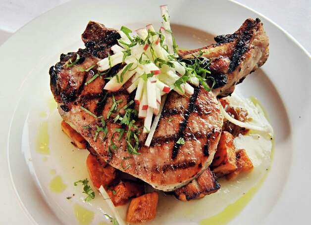 Double cut pork chop at Next Door Kitchen & Bar on Front Street Tuesday Oct. 28, 2014,in Ballston Spa, NY.  (John Carl D'Annibale / Times Union) Photo: John Carl D'Annibale / 00029223A