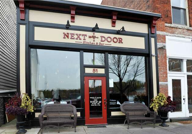 Entrance to the Next Door Kitchen & Bar on Front Street Tuesday Oct. 28, 2014,in Ballston Spa, NY.  (John Carl D'Annibale / Times Union) Photo: John Carl D'Annibale / 00029223A