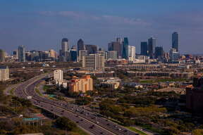DALLAS, TX - MARCH 20: The downtown skyline is viewed from the Renaissance Hotel off Stemmons Highway on March 20, 2013 in Dallas, Texas. Dallas, a major hub of technology, energy, medical research, and commerce, is the fourth largest metropolitan center in the United States. (Photo by George Rose/Getty Images)