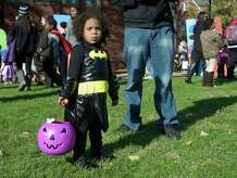 Natalie Pierre from New Haven came dressed as Batman to the 21st annual Halloween on the Green in Danbury, Conn, in 2013. This year's festivities take place Saturday, Nov. 1, from 2 to 4 p.m.