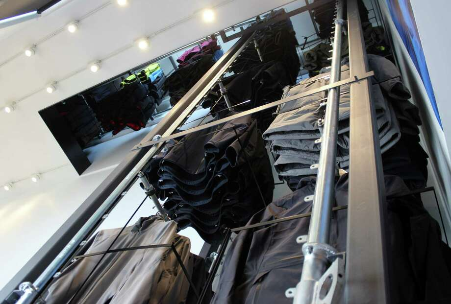 Aether uses a conveyor belt system to retrieve clothes from the upper floors. Photo: Stephanie Wright Hession / Special To The Chronicle / ONLINE_YES