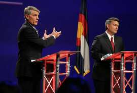 Sen. Mark Udall, D-Colo. (left), and his Republican opponent, Rep. Cory Gardner, face off during a televised debate in Denver Oct. 15.