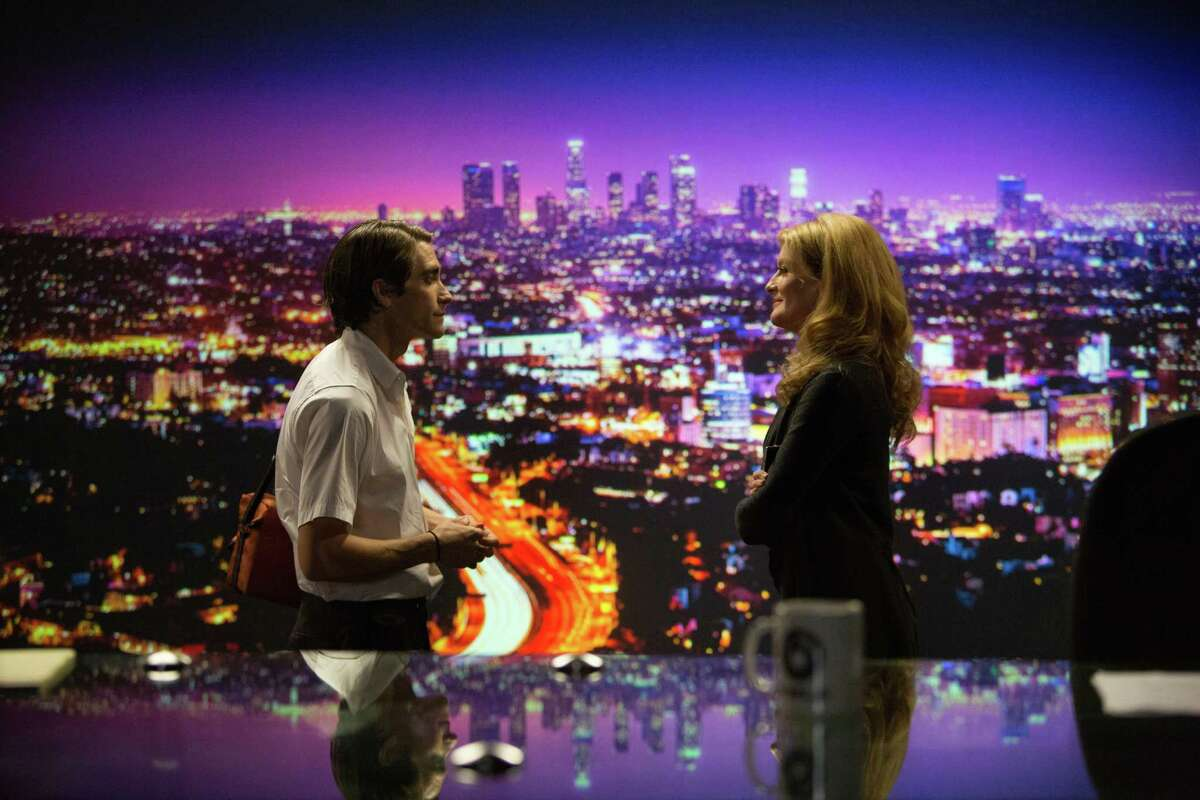 """In this image released by Open Road Films, Jake Gyllenhaal, left, and Rene Russo appear in a scene from the film, """"Nightcrawler."""" (AP Photo/Open Road Films, Chuck Zlotnick) ORG XMIT: NYET306"""
