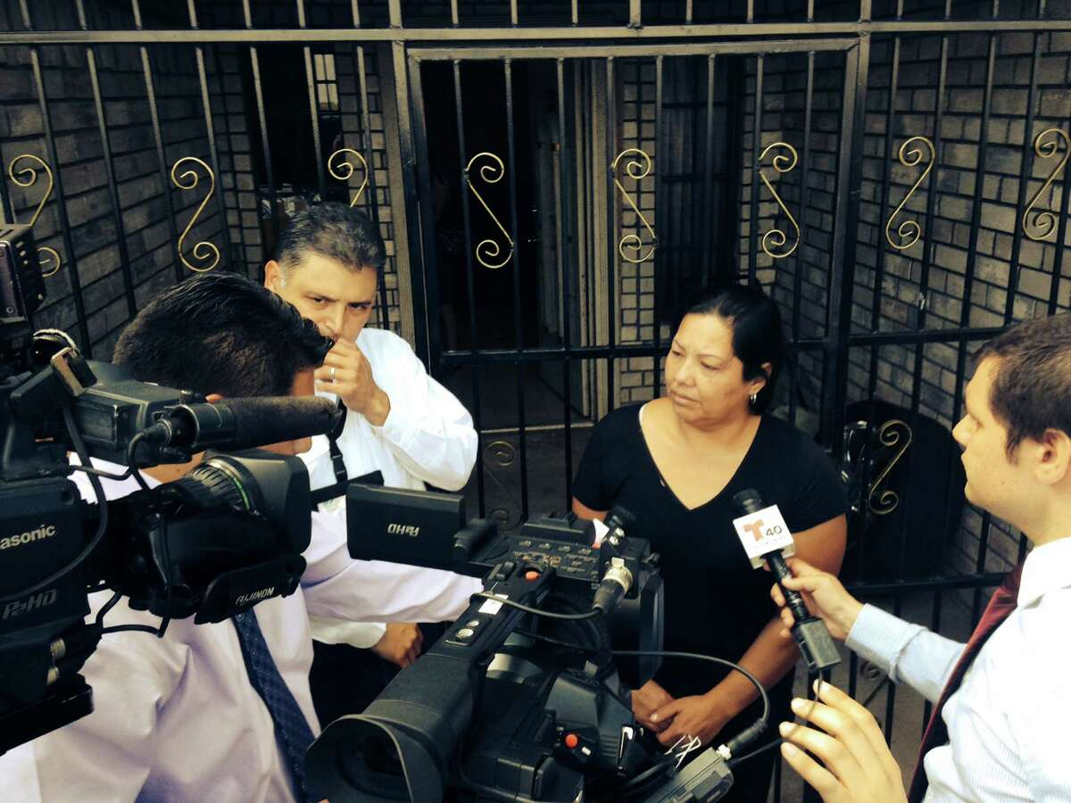 The Raquel Alvarado, mother of the three missing children in Matamoros, is interviewed by reporters outside her home in Progreso. The children who have been missing since Oct. 13, 2014, are Erica Alvarado Rivera, 26, Alex Alvarado, 22, and Jose Angel Alvarado, 21. Bodies of four people were found in Matamoros and are believed to be the three siblings along with the boyfriend of Alvarado Rivera.