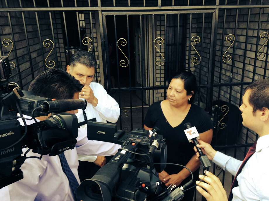 The Raquel Alvarado, mother of the three missing children in Matamoros, is interviewed by reporters outside her home in Progreso. The children who have been missing since Oct. 13, 2014, are Erica Alvarado Rivera, 26,  Alex Alvarado, 22, and Jose Angel Alvarado, 21. Bodies of four people were found in Matamoros and are believed to be the three siblings along with the boyfriend of Alvarado Rivera. Photo: Aaron Nelsen, SAEN / San Antonio Express-News