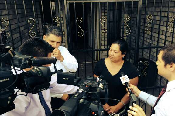 The Raquel Alvarado, mother of the three missing children in Maramoros, is interviewed by reporters outisde her home in Progreso. The children who have been missing since Oct. 13, 2014, are Erica Alvarado Rivera, 26,  Alex Alvarado, 22, and Jose Angel Alvarado, 21. Bodies of four people were found in Matamoros and are believed to be the three siblings along with the boyfriend of Alavardo Rivera.