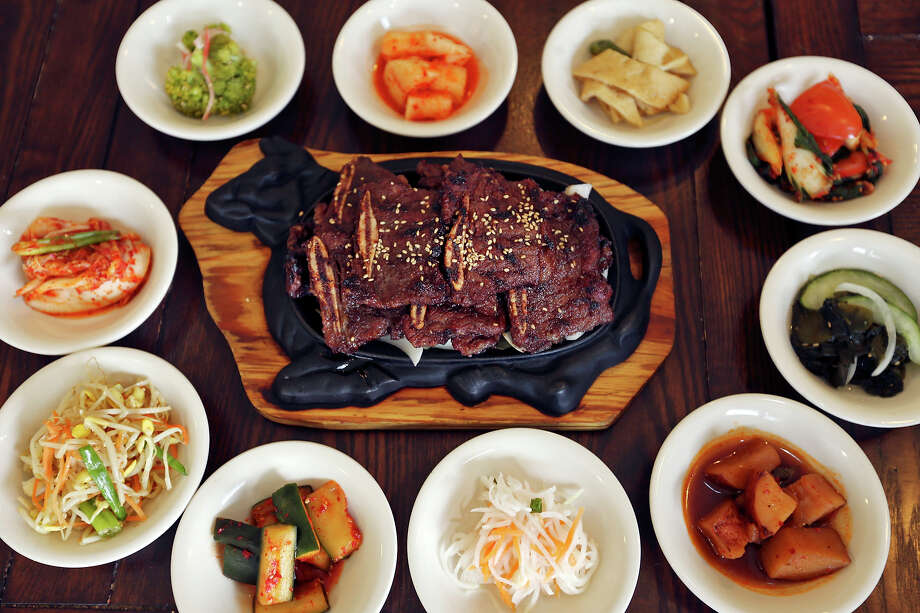 The LA Kalbi with banchan at Texas Brisket Bar-B-Q / Seoul Garden. Photo: Edward A. Ornelas / © 2014 San Antonio Express-News