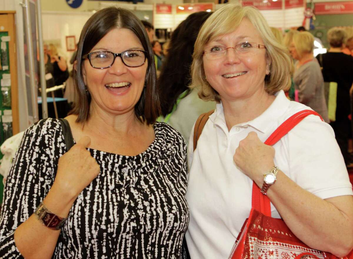 People pose during the International Quilt Festival at the George R. Brown Convention Center Thursday, Oct. 30, 2014, in Houston.